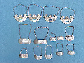 eight assorted bottle tickets, one by woman silversmith