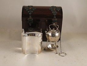 Tea caddy, strainer on stand, in wood domed chest