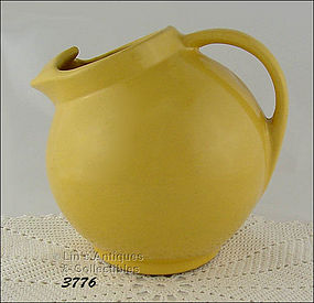 McCOY POTTERY – EARLY BALL SHAPED PITCHER / JUG (YELLOW