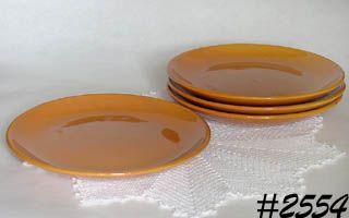 McCOY POTTERY -- 4 SUBURBIA WARE DINNER PLATES (ORANGE)