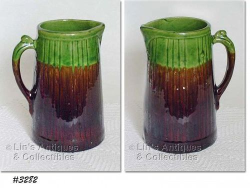 McCOY POTTERY -- STONEWARE PITCHER (BROWN AND GREEN)