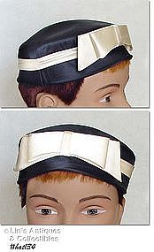 BLACK HAT WITH IVORY COLOR BOW/BAND -- LUCI PUCI