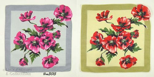 TWO HANKIES WITH LOTS OF POPPIES AND A SHAPED CORNER