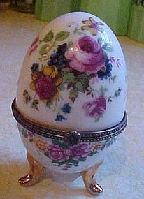 Pretty porcelain egg hinged trinket box on three feet