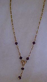 Avon Goldtone drop necklace with ruby crystal beads