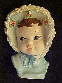 Baby girl in blue bonnet small head vase spaghetti trim