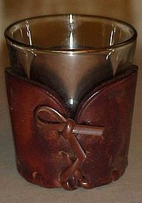 Three shot glasses with leather cozy