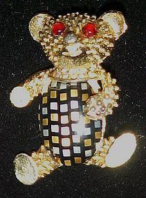 Vintage teddy bear pin with celluloid plaid belly
