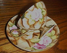 Vintage hand painted large rose chintz cup and saucer