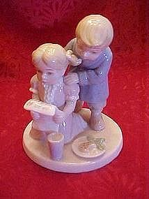 Lladro style children with note from Santa, figurine
