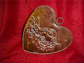 Copper heart mold with love birds in nest