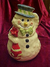 Snowman holding a sack, cookie jar