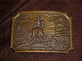 Cowboy and wagon train, brass belt buckle