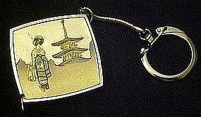 Vintage Jet line mini tape measure key chain. Geisha