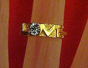 Gold tone LOVE ring with blue topaz birthstone