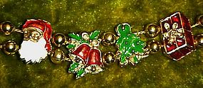 Gold tone Christmas charms slide bracelet,